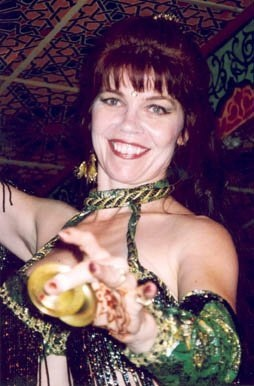 Anthea dancing with finger cymbals at Casablanca by             Basima